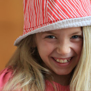 Portrait of a young girl with her pink hat on