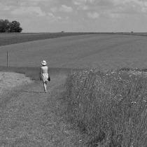 Lady walking on the hillside