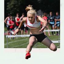 Gloucester athlete running hurdles.