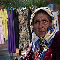 Roma lady selling second had clothes in a flee market